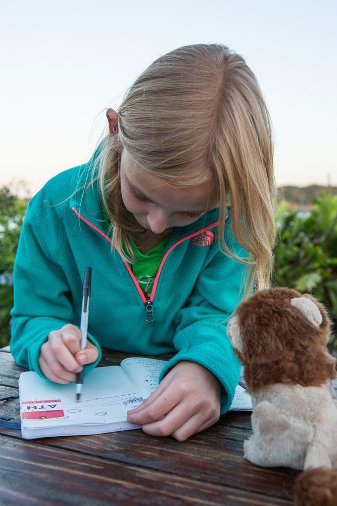 Kara with her travel Journal