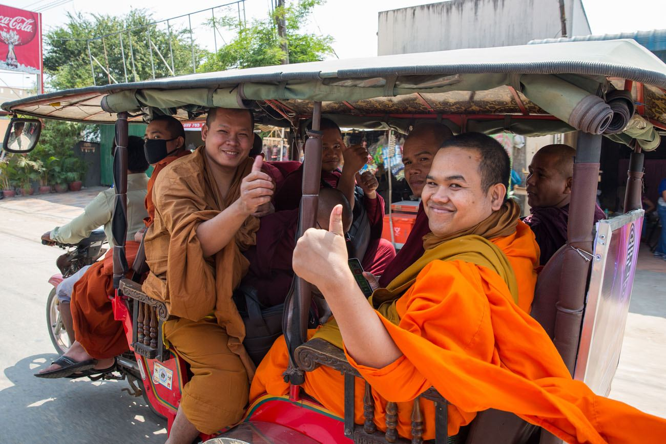 Monks in a tuk tuk
