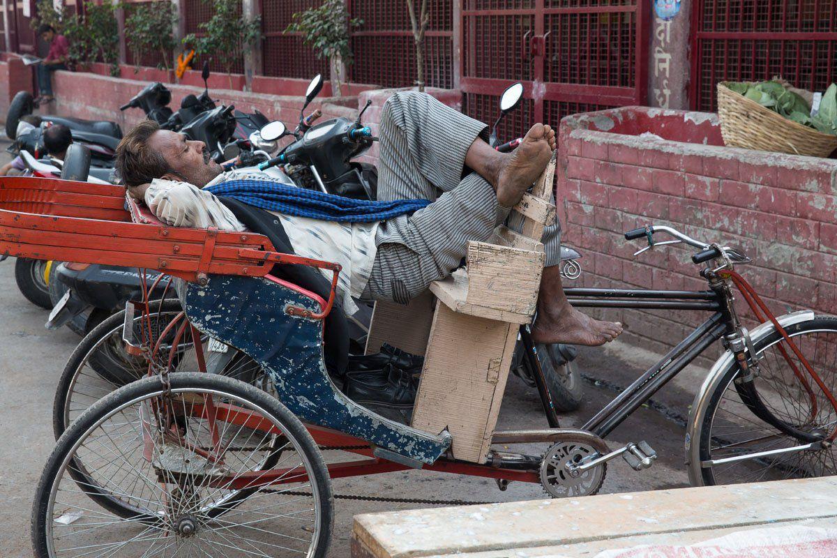 Sleeping rickshaw driver